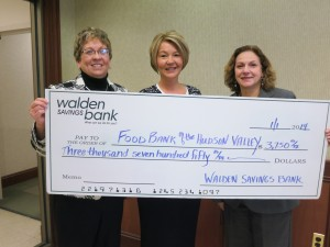 Walden Savings Bank's Corporate Receptionist, Rachel Millspaugh, and Vice President Marketing Joann Menendez present Antonetta C. Gutter, Director of Development for Food Bank of the Hudson Valley, with a check in the amount of $3,750 from its 2013 Ornament Campaign.
