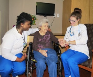 Mount St. Mary College nursing students, Saski Senorine and Amanda Fox, with Elant at Meadow Hill resident, Evelyn Anderson (middle).