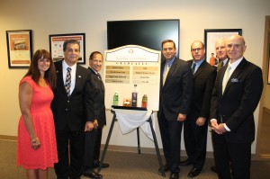 (From Left to Right): Kelly Reilly, client services specialist of the Orange County Business Accelerator; James R. Petro, Jr., executive director of the Orange County Industrial Development Agency; Edward A. Diana, former Orange County Executive; Steven M. Neuhaus, Orange County Executive; Laurence P. Gottlieb, president and CEO of the Hudson Valley Economic Development Corporation; Robert Armistead, chairman of the Orange County Industrial Development Agency Board of Directors; and Michael J. DiTullo, the original executive director of the Orange County Business Accelerator with the graduate plaque.