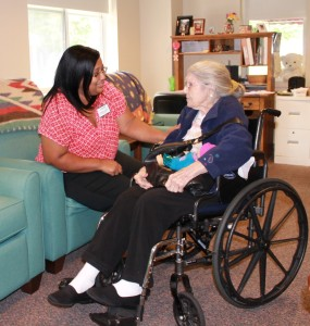 Holly Berry, R.N., Elant at Goshen adult day program director, chats with Ethel Davis, a dementia client, in the adult day program's Quiet Reflections room.