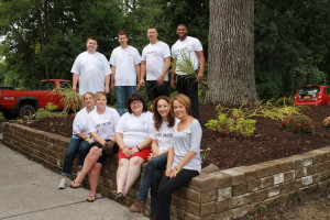 Gathering after completion of their beautification work are, in the rear and from the left: Jordan Mentry, Joe Cuccia, DeWayne Haygood and Kyle Richardson. Front row: Linda Shuback, left, Maria Gardner, Haydee Furman, Michelle Nepton of United Way and Pat Roza of Elant at Fishkill.