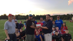 Jeff VanWagenen (right), manager United Water Owego Nichols, presents a check to Adam Cole (center), vice president of the Owego Junior Football League, and Tom Taft (left), president of the league.