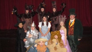 """Some of the cast of the George F. Baker High School's production of """"The Wizard of Oz."""" In the back row, """"trees"""" Tara Odell, left, Taylor Spivak and Madeline Doyle. Middle row: Rosalie Rodriquez, left, as the Wicked Witch;  Rachel Levinsky, as the Tin Man; Daria Fatemi, as Dorothy; Heidi Willins as Glenda the Good Witch; and Assistant Principal  Eric Sorenson as the Wizard of Oz. Bottom row: Matt Willins, left, as the Scarecrow;  and John Castricone as the Cowardly Lion."""