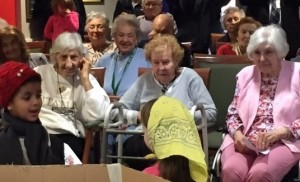 "Smiling Promenade at Tuxedo Park residents enjoy watching the George Grant Mason School kindergarten class' production of ""The Mitten.""  Students took the short trip the senior residence to reprise the show they performed several weeks back at the school."